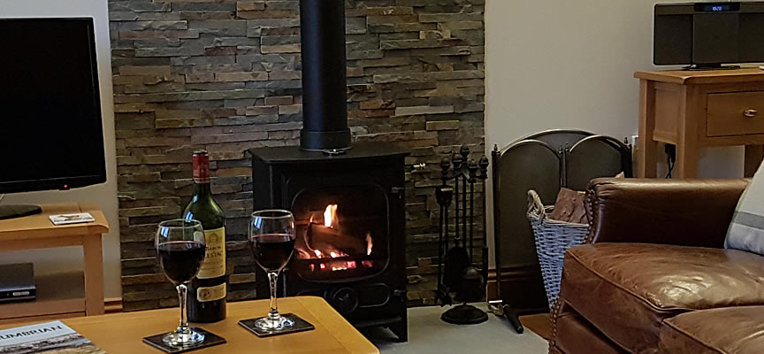 Image: Log burner in this dog-friendly holiday cottage near Hadrian's Wall.